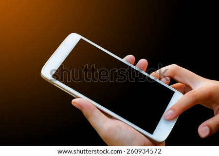 woman hand hold and touch screen smart phone,tablet,cellphone isolated on black , abstract background for mobile banking,online banking concept. - stock photo
