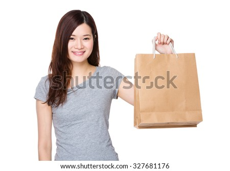 Woman hand hold with paper bag