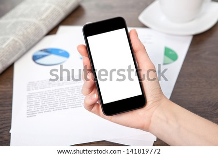 woman hand holding a touch phone with isolated screen on the table with graphics - stock photo
