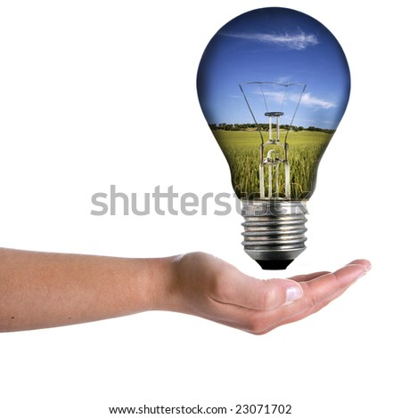 woman hand holding bulb with spring landscape isolated on white background