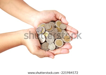 Woman hand holding coin isolated on white background