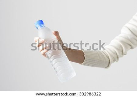 Woman Hand Holding Cold Water Bottle. Concept for Healthy Life