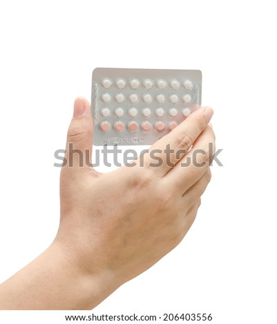 Woman hand holding contraceptives against a white background - stock photo