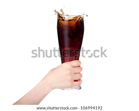 Woman hand holding fresh Cola with ice cubes on a white