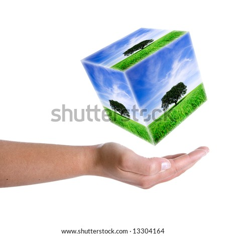 woman hand holding landscape cube in 3d - earth nature and environment concept - stock photo