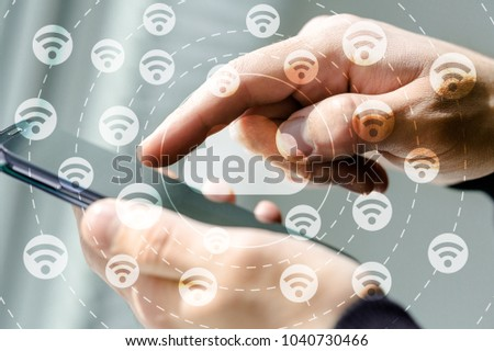 Woman hand holding mobile phone