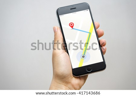 Woman hand holding mobilephone with program of navigation. The navigation software is on your phone. - stock photo