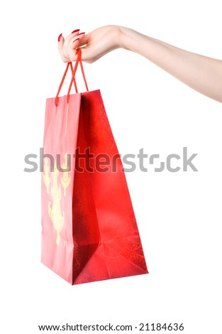 Woman hand holding shopping bag. Isolated on white.