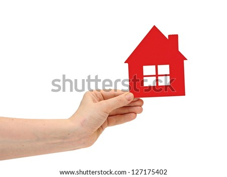 woman hand holding small red plastic house over white background - stock photo
