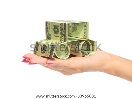 woman hand Holding The car made of Dollars