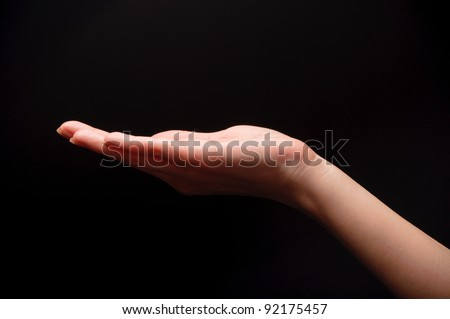 woman hand on black background - stock photo