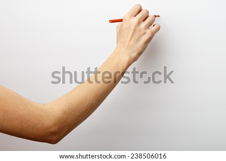 Woman hand on Isolated white background. Alpha. Hand with a pencil.