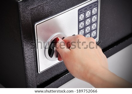 woman hand opened a safe, close up - stock photo
