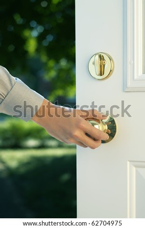 woman hand opening door - stock photo