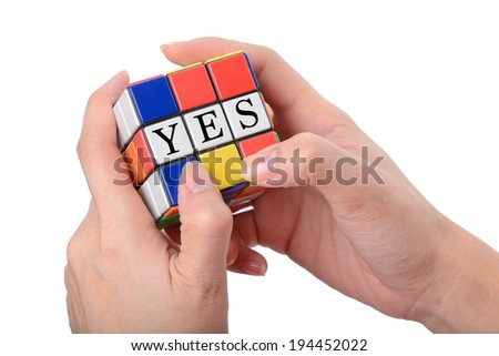 woman hand playing square puzzle for concept solve solution with white background - stock photo
