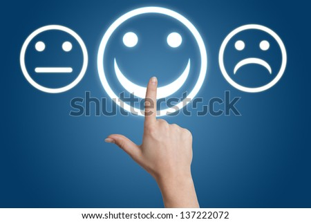 woman hand pointing to a positive feedback button on blue background - stock photo