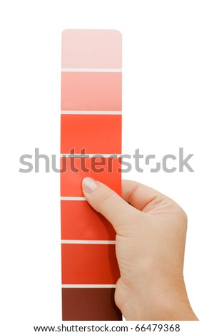 Woman hand pointing to a sample color chart - stock photo
