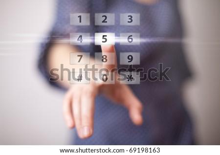 woman hand pressing digital button - stock photo