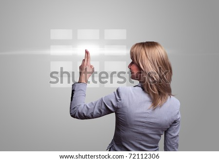 woman hand pressing digital buttons - stock photo