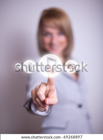 woman hand pressing MUSIC button, backround in bokeh