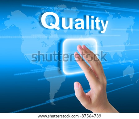 woman hand pressing quality button on a touch screen interface - stock photo