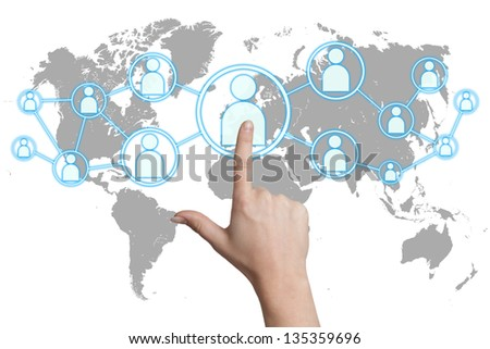woman hand pressing social media icon on white background with world map - stock photo