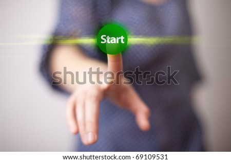 woman hand pressing START button