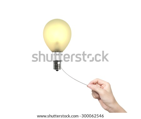 Woman hand pulling rope connected yellow lightbulb shape hot air balloon, isolated on white background. - stock photo