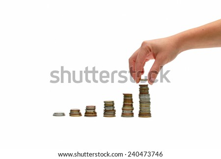 woman hand putting money coins to stack over white - stock photo