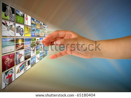 Woman hand reaching images on the screen - stock photo
