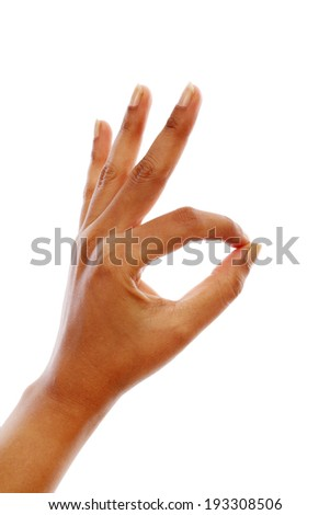 Woman hand showing OK sign gesture against white background - stock photo