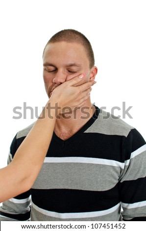 Woman hand slapping man's face. Isolated on white.