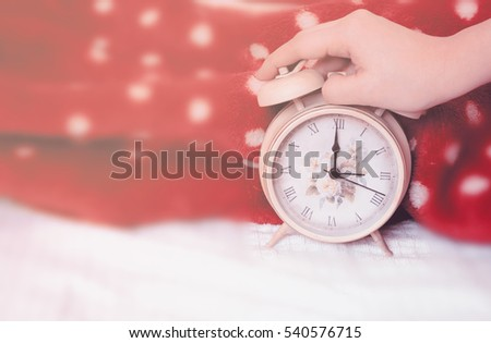 woman hand stopping alarm sounds on stock photo royalty free