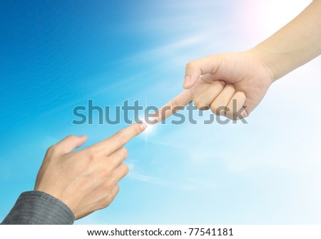 woman hand touch businessman hand on blue sky background - stock photo