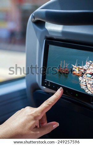 woman hand touching the lcd screen at bus - stock photo