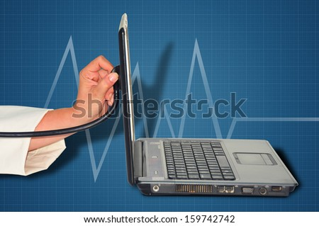 woman hand with a stethoscope and a laptop     - stock photo