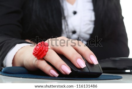 Woman hand with computer mouse on a white background - stock photo