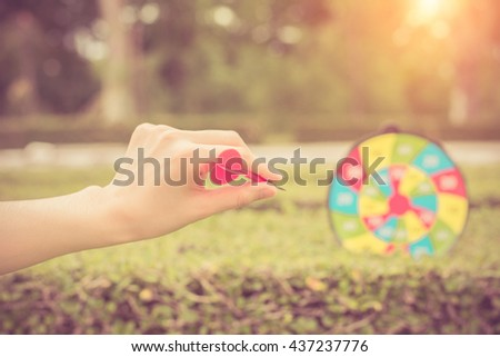 Woman hand with dart closeup.abstract background to target marketing or target arrow concept . - stock photo