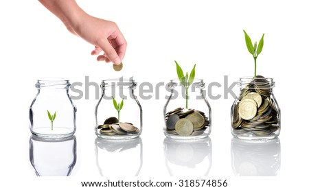 woman hand with Mix coins and seed in clear bottle on white background,Business investment growth concept,saving concept - stock photo