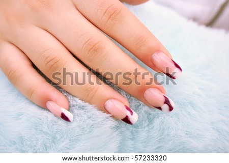 Woman hand with nail art onblue fur  background.