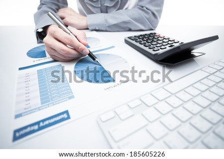 woman hand with pen and business report. Accounting - stock photo