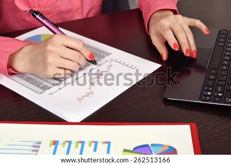 woman hand with pen calculate income - stock photo