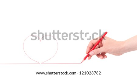 woman hand with pencil draws the heart, isolated on a white background - stock photo