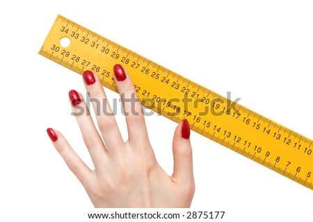Woman hand with ruler. Isolated on white.