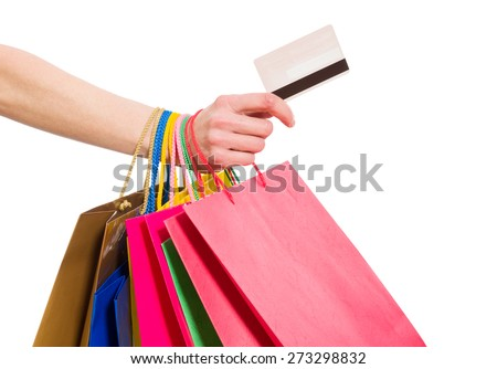 Woman hand with shopping bags and credit card on white background