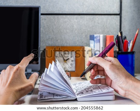 Woman hand working on modern office desk background - stock photo