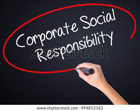 Woman Hand Writing Corporate Social Responsibility on blank transparent board with a marker isolated over black background. Stock Photo