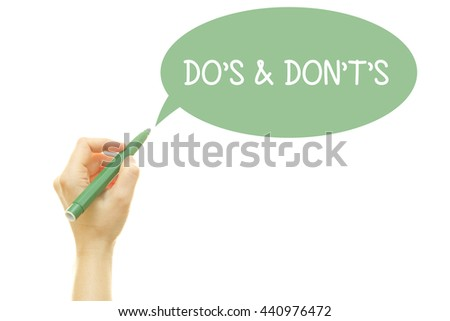 Woman hand writing Do's and Don't's Message with a marker isolated on white. - stock photo