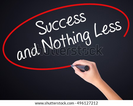 Woman Hand Writing Success and Nothing Less on blank transparent board with a marker isolated over black background. Business concept. Stock Photo
