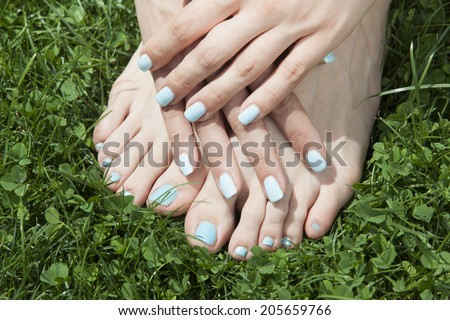 woman hands and foot on grass   - stock photo